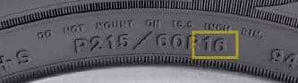 Tire rim diameter P215/60R16 highlighted on a passenger tire's sidewall
