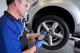 Goodyear technician installing a new tire