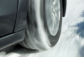 winter tire driving through snow